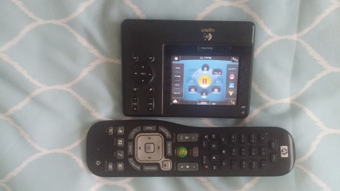 HP Media Center remote next to the Harmony 1100